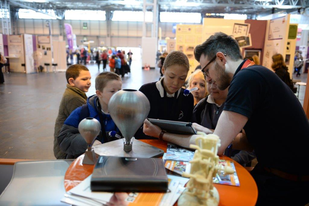 Renishaw employee with children at Big Bang Fair 2014