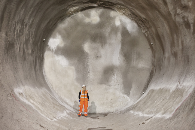 Crossrail Section Engineer Olivia Perkins inspects the new Crossrail passenger tunnels being constructed under London's Oxford Street