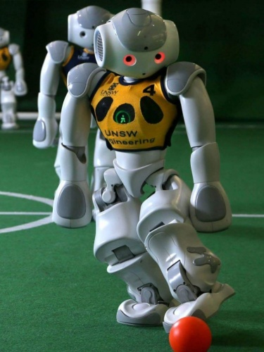 UNSW robot kicks a ball in the RoboCup World Championships