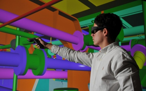 The BAE VR system uses laser tracking and a wand to allow users to interact with the vessels in a 3D environment.