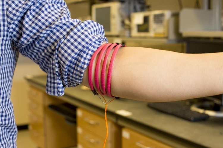 Prototype of the magnetic field human body communication, developed in Mercier's Energy-Efficient Microsystems Lab at UC San Diego, consists of magnetic-field-generating coils wrapped around three parts of the body, including the head, arm and leg.