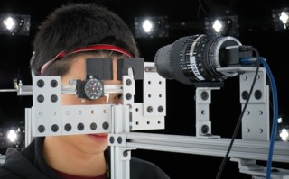 The device contains a skin measurement gantry that consists of callipers that either compress or stretch patches of the subject's facial skin, which is recorded by the camera macro lens.