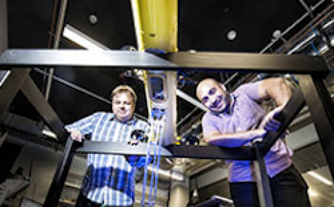 Drs Matthew Dunbabin (left) and Feras Dayoub (right) have developed the COTSbot, the world's first robot designed to control the Great Barrier Reef's crown-of-thorns starfish population