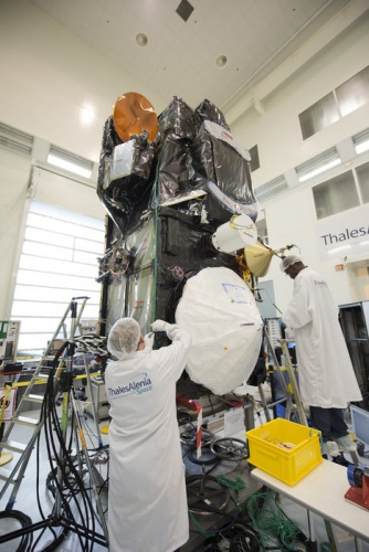 Scientists and engineers work on Sentinel 3A in the cleanroom.
