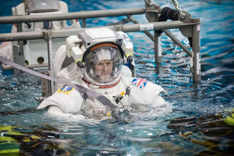 TIm Peake training in the EVA suit for spacewalk in NASA's pool