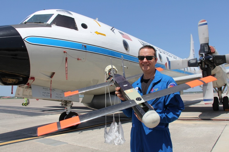 Dr Joe Cione with the Coyote in front of the NOAA's P-3 aircraft (Source: NOAA)