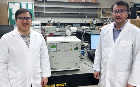 Amin Salehi-Khojin, assistant professor of mechanical and industrial engineering (right), and postdoctoral research associate Mohammad Asadi with their specially modified differential electrochemical mass spectrometry (DEMS) instrument. © UIC College of Engineering