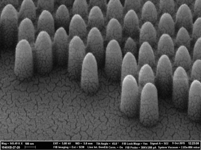 A scanning electron miscroscope photograph shows the pyramid-like nanostructures engraved onto glass: at 200nm they are 100 times smaller than a human hair. Controlling the surface morphology at the nanoscale allows scientists to tailor how the glass interacts with liquids and light with high precision
