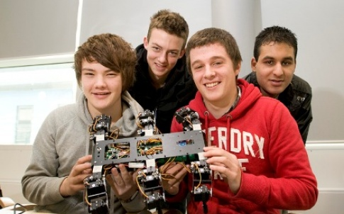 Young engineers show off a robot car they have built. Image courtesy of Diamond Light Source