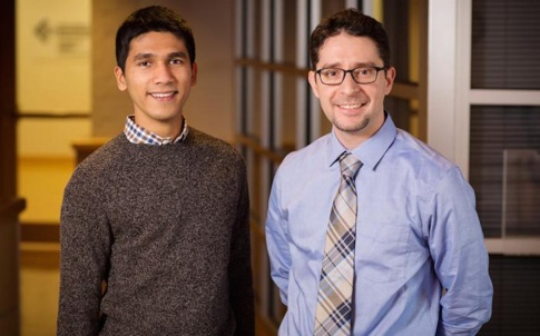 Inspired by the principles of a conventional sodium ion battery, Illinois mechanical science and engineering professor Kyle Smith, right, and graduate student Rylan Dmello found they could desalinate salt water more efficiently than using traditional methods (Photo by L. Brian Stauffer)