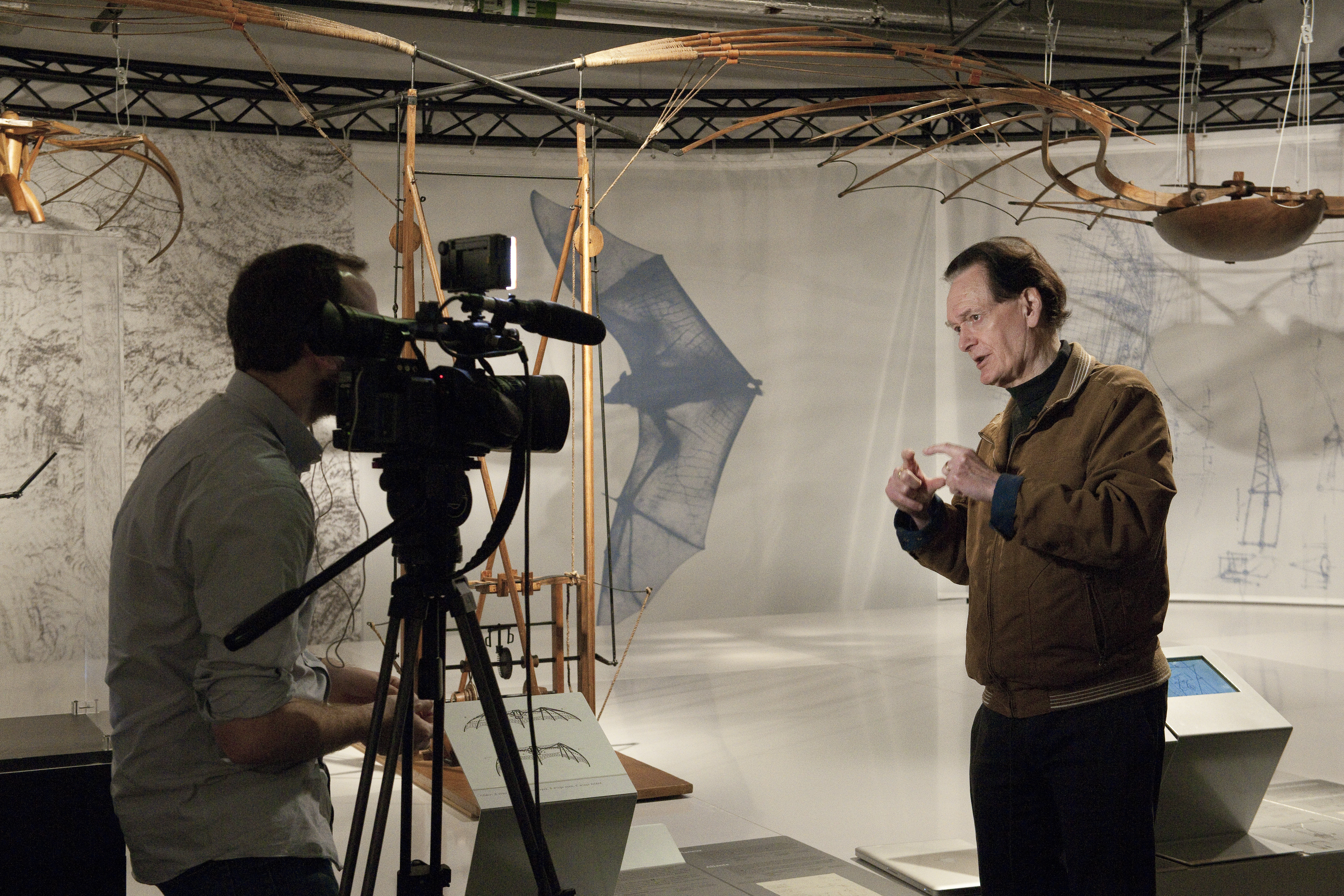 "Prof Martin Kemp pictured being interviewed at the opening of ""Leonardo da Vinci: The Mechanics of Genius"" exhibition. Prof Kemp is the emeritus professor of the history of art at University of Oxford is considered one of the world's leading experts on the art of Leonardo da Vinci and visualisation in art and science."