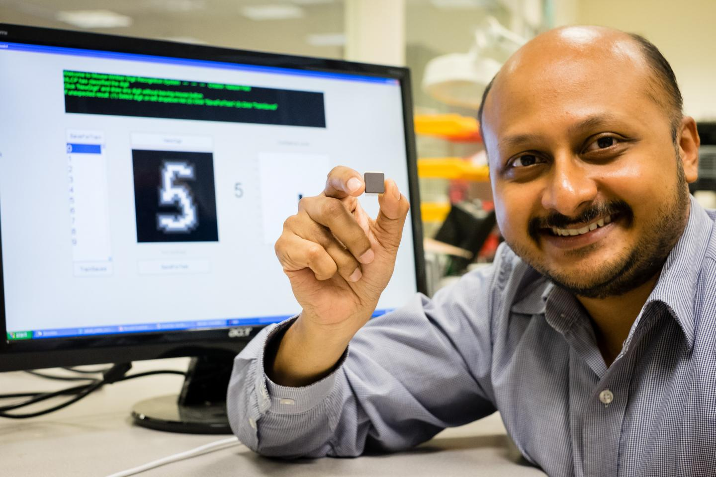 NTU Asst Prof Arindam Basu is holding his low-powered smart chip.NTU Asst Prof Arindam Basu is holding his low-powered smart chip. Image courtesy of NTU Singapore