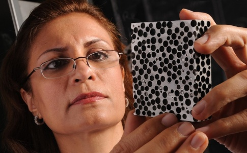 Afsaneh Rabiei examines a sample of composite metal foam
