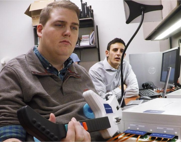 Ian Burkhart playing a guitar computer game (Credit: Ohio State University Wexner Medical Center)