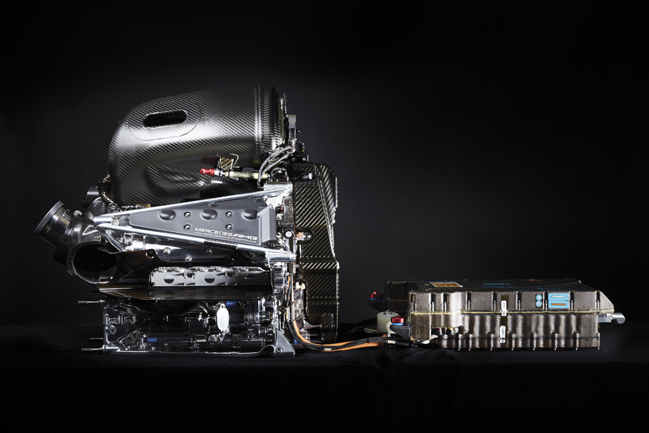 Hybrid system; the ICE works in concert with electrical machines powered by the battery, right