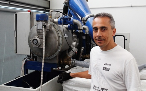 Roberto Papalia, technical director from Italian partners, Nova Engineering, pictured at the AMRC with an innovative waterjet recycling system developed for the REFORM project, which was tested and demonstrated using the AMRC's waterjet cutter. The system cuts the cost and environmental impact of using waterjets to cut composites by filtering and separating the abrasive particles from the water for reuse.