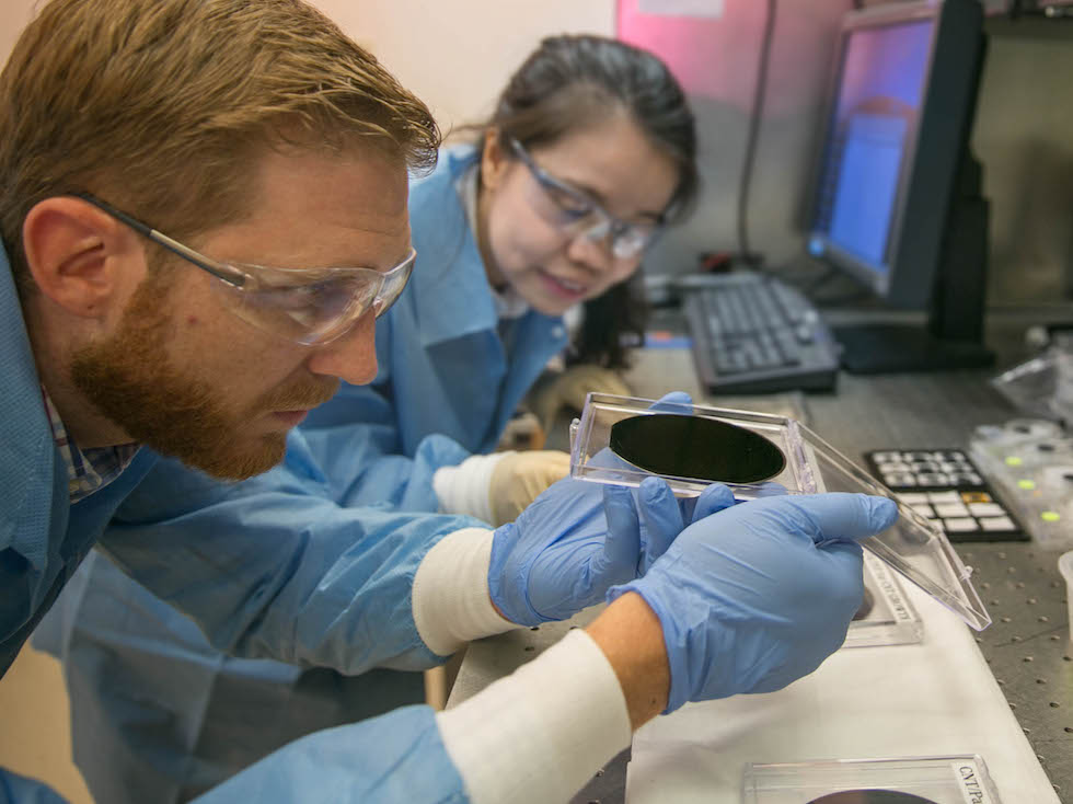 Researchers Eric Meshot, left, and Ngoc Bui evaluate the uniformity of a carbon nanotube array covering the entire area of a 4-inch wafer [Photo by Julie Rusell/LLNL]