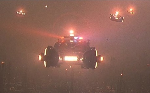 Flying cars loom through the city smog in Blade Runner