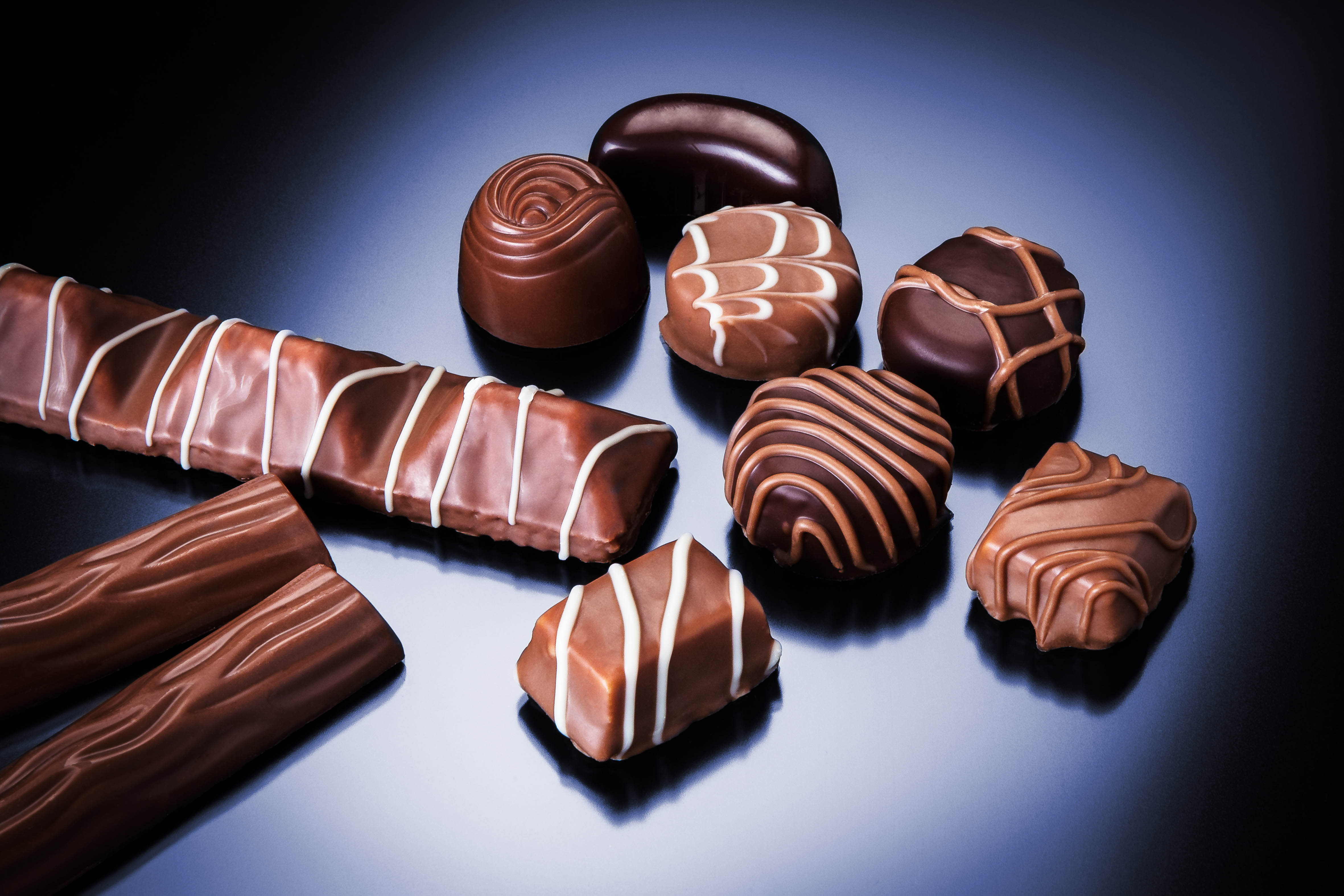 chocolate products Chocolate is a range of foods derived from cocoa (cacao), mixed with fat (eg,  cocoa butter)  the cocoa bean (or other alternative) products from which  chocolate is made are known under different names in different parts of the world  in the.