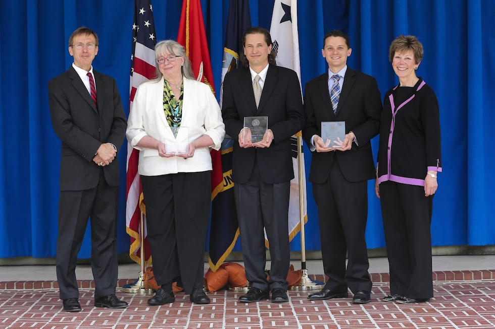 Debra R. Rolison (2nd from left), Jeffrey W. Long (center), and Joseph F. Parker (4th from left)