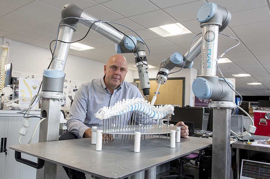 Robotic arms could give surgeons a hand in future spinal surgery