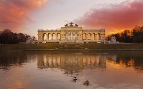 Gloriette Vienna at dusk, reflection cloudscape on pond