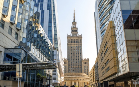Street view in the business center with palace of culture and modern towers in Warsaw, Poland