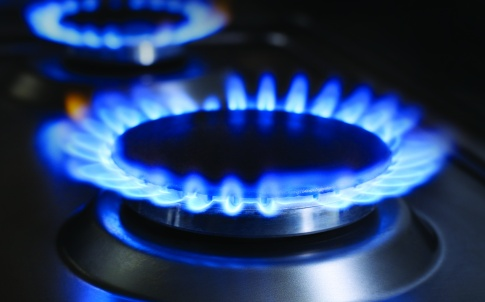 Blue flames from gas stove burner. High res photo of blue flames from a kitchen gas range.