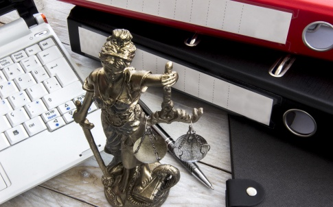 Law concept, statue, laptop and folder on wood table