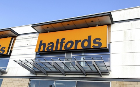 Swansea, UK: May 18, 2016: Halfords shop front. Halfords Group plc is a British retailer of car parts, car enhancement, camping, touring and bicycles operating in the UK and Ireland.