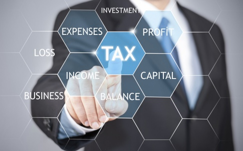 Businessman hand touching tax word on virtual screen the concept of online taxation.