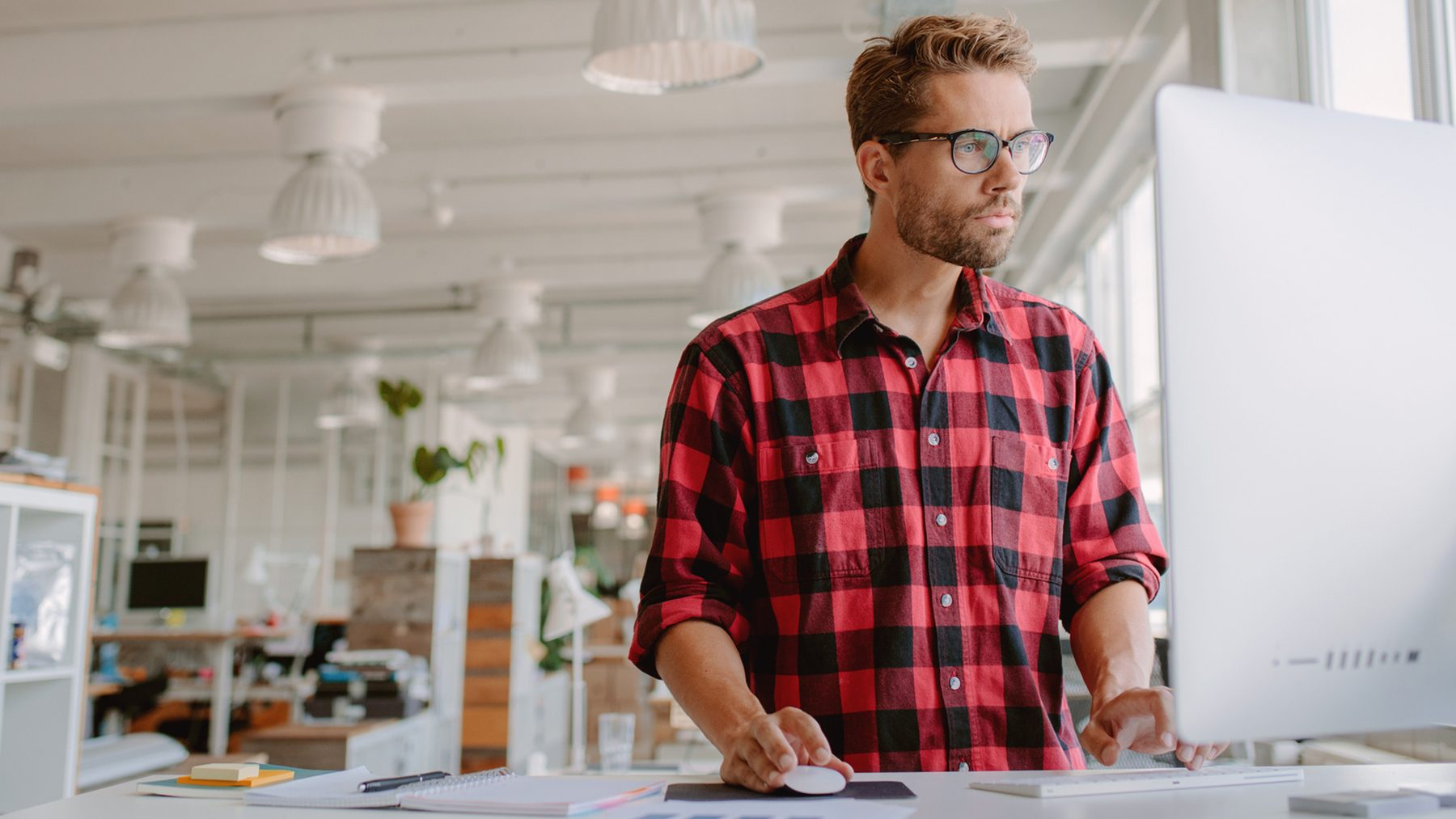 young-man-working-on-computer-in-modern-workplace