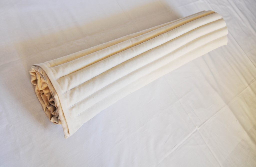 rolled up mustard seeds mattress by EcoHealthLAB
