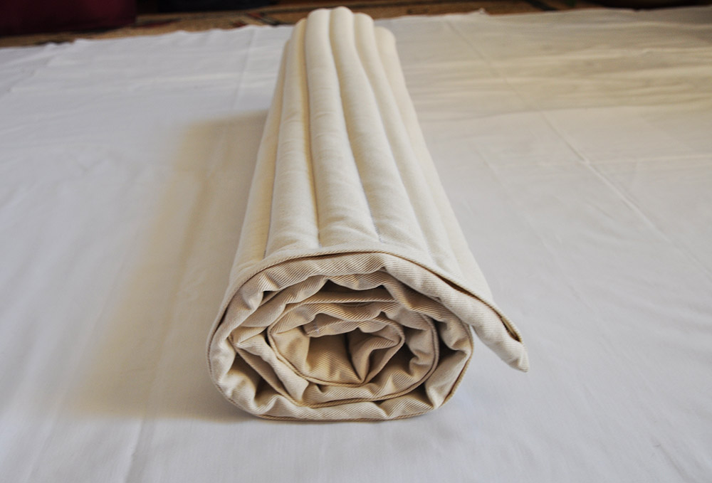 rolled up mustard seed mattress