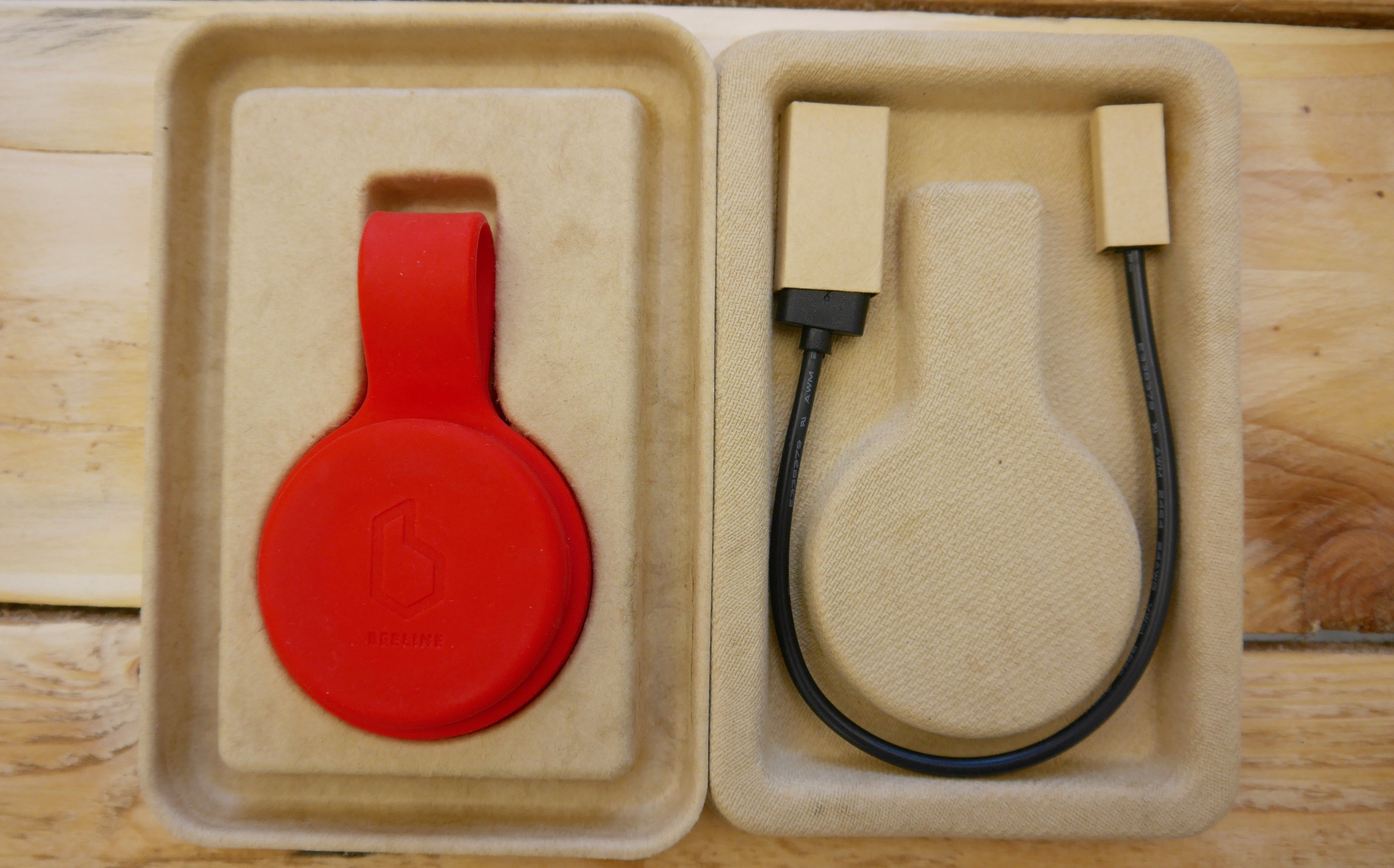 Beeline Velo package open to show where the micro USB charging cable is