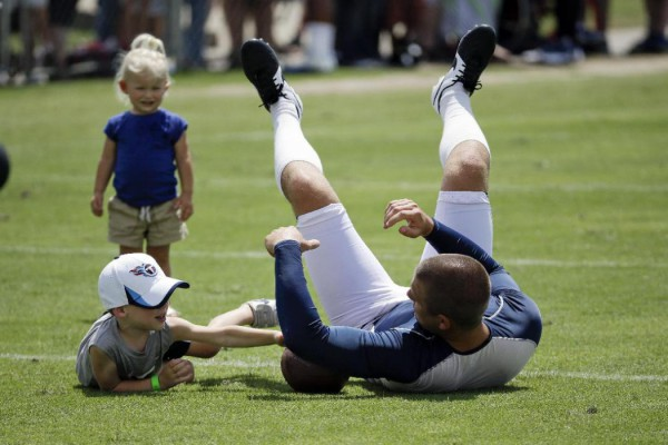 Tennessee Titans punter Brett Kern plays with his son, Bryce, 4, and daughter, Anelle, 2, after practice during NFL football training camp Monday, July 28, 2014, in Nashville, Tenn (AP Photo Mark Humphrey)