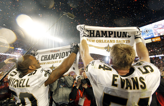 New Orleans Saints line backers Marvin Mitchell (50) and Troy Evans (54) hold up Champion towels after the Saints defeated the Indianapolis Colts 31-17 in Super Bowl XLIV at Sun Life Stadium in Miami on February 7, 2010. UPI/John Angelillo (Newscom TagID: upiphotos991711) [Photo via Newscom]