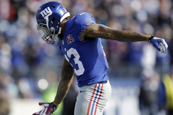 New York Giants wide receiver Odell Beckham Jr. (13) celebrates a 15-yard touchdown pass against the Tennessee Titans in the first half of an NFL football game Sunday, Dec. 7, 2014, in Nashville, Tenn. (AP Photo/Mark Zaleski)