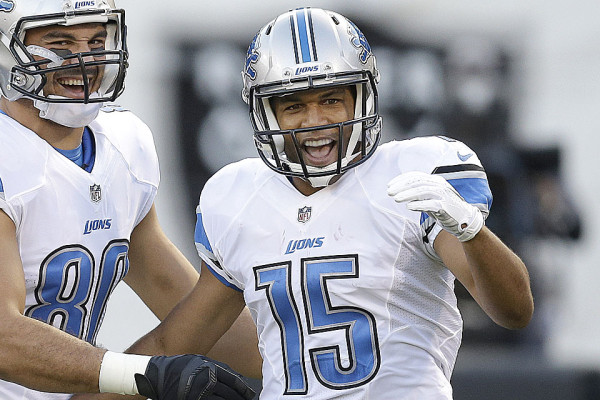 Detroit Lions wide receiver Golden Tate (15) celebrates after scoring on a 28-yard touchdown reception with tight end Joseph Fauria during the first quarter of an NFL preseason football game against the Oakland Raiders in Oakland, Calif., Friday, Aug. 15, 2014. (AP Photo/Ben Margot)