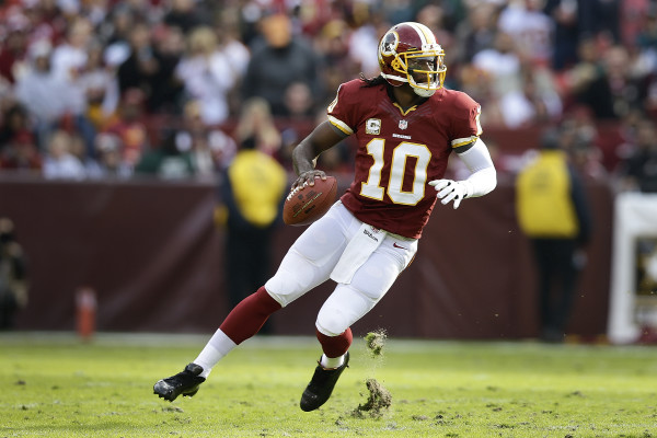 Washington Redskins quarterback Robert Griffin III looks for an opening to throw during the first half of an NFL football game against the Philadelphia Eagles in Landover, Md., Sunday, Nov. 18, 2012. (AP Photo/Alex Brandon)