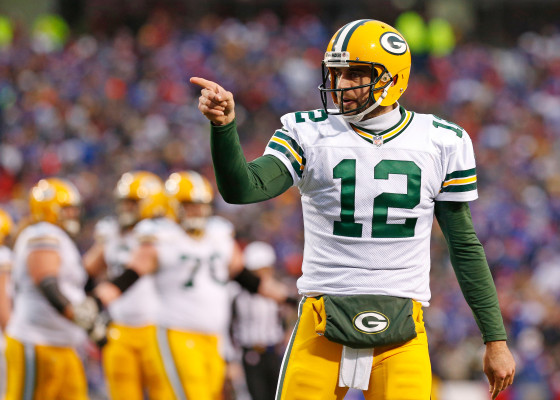 Dec 14, 2014; Orchard Park, NY, USA; Green Bay Packers quarterback Aaron Rodgers (12) gestures during the game against the Buffalo Bills at Ralph Wilson Stadium. The Bills beat the Packers 21-13. Mandatory Credit: Kevin Hoffman-USA TODAY Sports