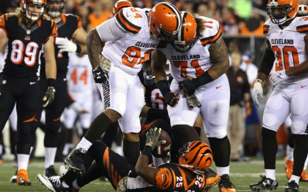 Nov 5, 2015; Cincinnati, OH, USA; Cleveland Browns defensive end Randy Starks (94) and nose tackle Danny Shelton (71) stand over Cincinnati Bengals running back Giovani Bernard (25) in the first half at Paul Brown Stadium. Mandatory Credit: Aaron Doster-USA TODAY Sports