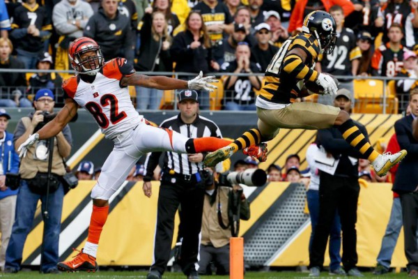 Pittsburgh Steelers cornerback Antwon Blake (41) intercepts a pass intended for Cincinnati Bengals wide receiver Marvin Jones (82) in the fourth quarter of an NFL football game, Sunday, Nov. 1, 2015, in Pittsburgh. The Bengals won 16-10. (AP Photo/Gene J. Puskar)