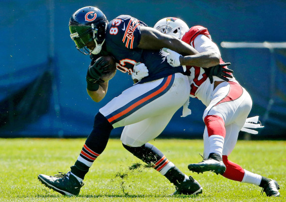CHICAGO, IL - SEPTEMBER 20: Tony Jefferson #22 of the Arizona Cardinals tackles Martellus Bennett #83 of the Chicago Bears during the first half at Soldier Field on September 20, 2015 in Chicago, Illinois.The Arizona Cardinals won 48-23. (Photo by Jon Durr/Getty Images)