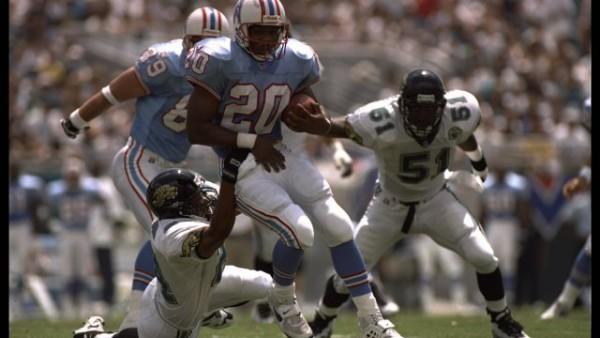3 Sep 1995: Running back Rodney Thomas of the Houston Oilers is snagged by a Jacksonville Jaguar defender in Jacksonville, Florida. The Oilers defeated the Jaguars 10-3. Mandatory Credit: Doug Pensinger/Allsport