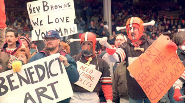 """CLEVELAND, OH - NOVEMBER 5: Cleveland Browns fans, some dressed in the team's """"Dog Pound"""" attire, show both their love for the team and their displeasure with Browns owner Art Modell before Cleveland's 05 November game at Municipal Stadium against the Houston Oilers. Reportedly, it will be announced 06 November that Modell plans to move the team to Baltimore, Maryland at the end of the season. The Houston Oilers defeated the Browns 37-10. AFP PHOTO (Photo credit should read KIMBERLY BARTH/AFP/Getty Images)"""