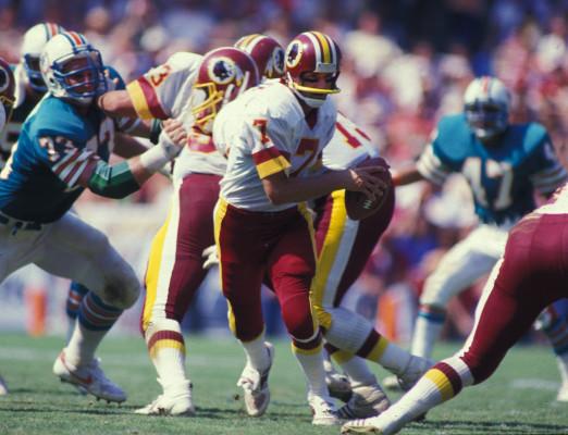 Washington Redskins Joe Theismann (7) in action during a game against the Miami Dolphins at the Orange Bowl in Miami, Florida. Joe Theismann played for the Washington Redskins from 1974-1985(AP Photo/David Durochik)