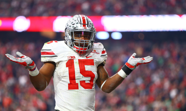 Jan 1, 2016; Glendale, AZ, USA; Ohio State Buckeyes running back Ezekiel Elliott (15) reacts in the end zone as he celebrates a second half against the Notre Dame Fighting Irish during the 2016 Fiesta Bowl at University of Phoenix Stadium. The Buckeyes defeated the Fighting Irish 44-28. Mandatory Credit: Mark J. Rebilas-USA TODAY Sports ORG XMIT: USATSI-233950 ORIG FILE ID: 20160101_mjr_su5_055.JPG