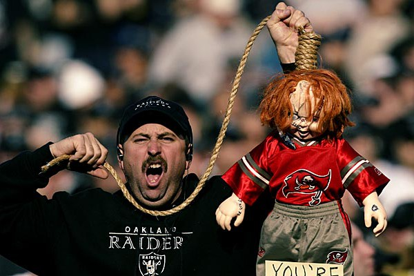 OAKLAND, CA - JANUARY 19: An Oakland Raiders fan hold up a Chucky doll emblematic of Jon Gruden in anticipation of a match up with Gruden's Tampa Bay Buccaneers prior to the start of the AFC Championship game against the Tennessee Titans at Network Associates Coliseum on January 19, 2003 in Oakland, California. The Raiders defeated the Titans 41-24, sending them on to the NFL title game for the first time since 1984. (Photo by Brian Bahr/Getty Images)