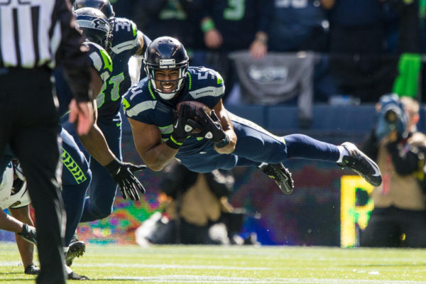 One of the most spectacular plays of the day game as linebacker Bobby Wagner tipped a pass then dove to make the interception.